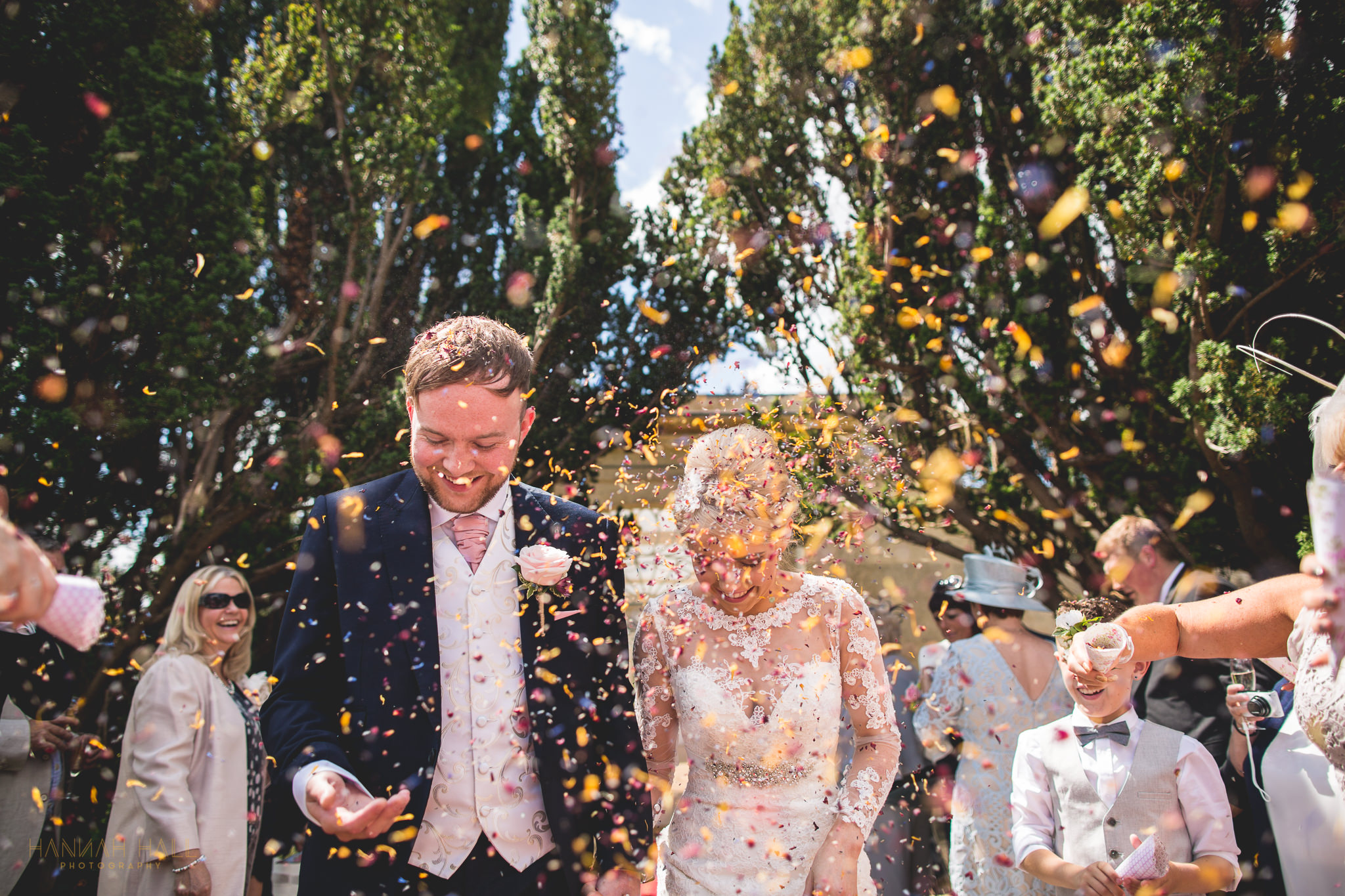 Couple showered in confetti at Barton Hall.
