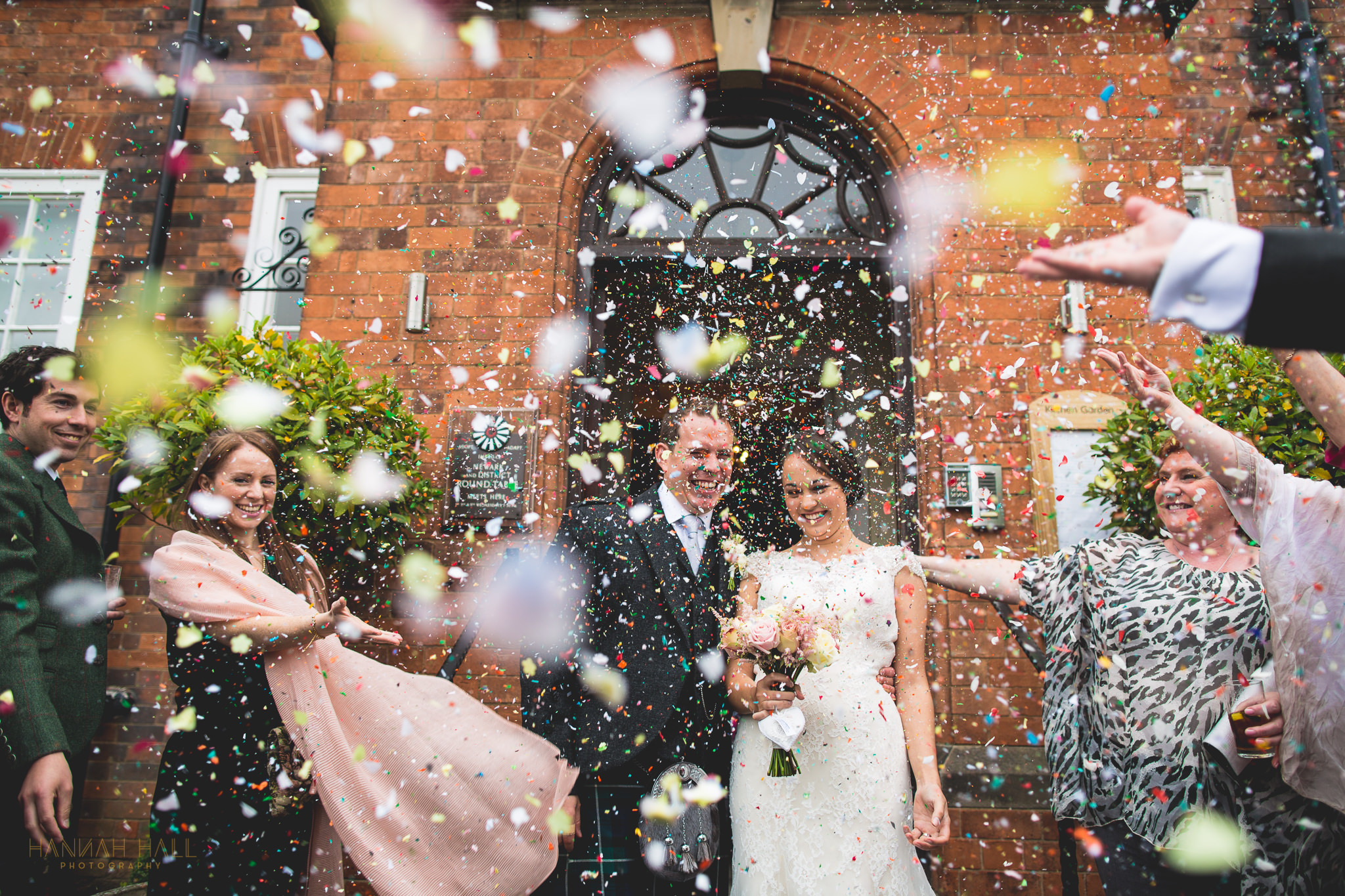 couple in confetti at Kelham House