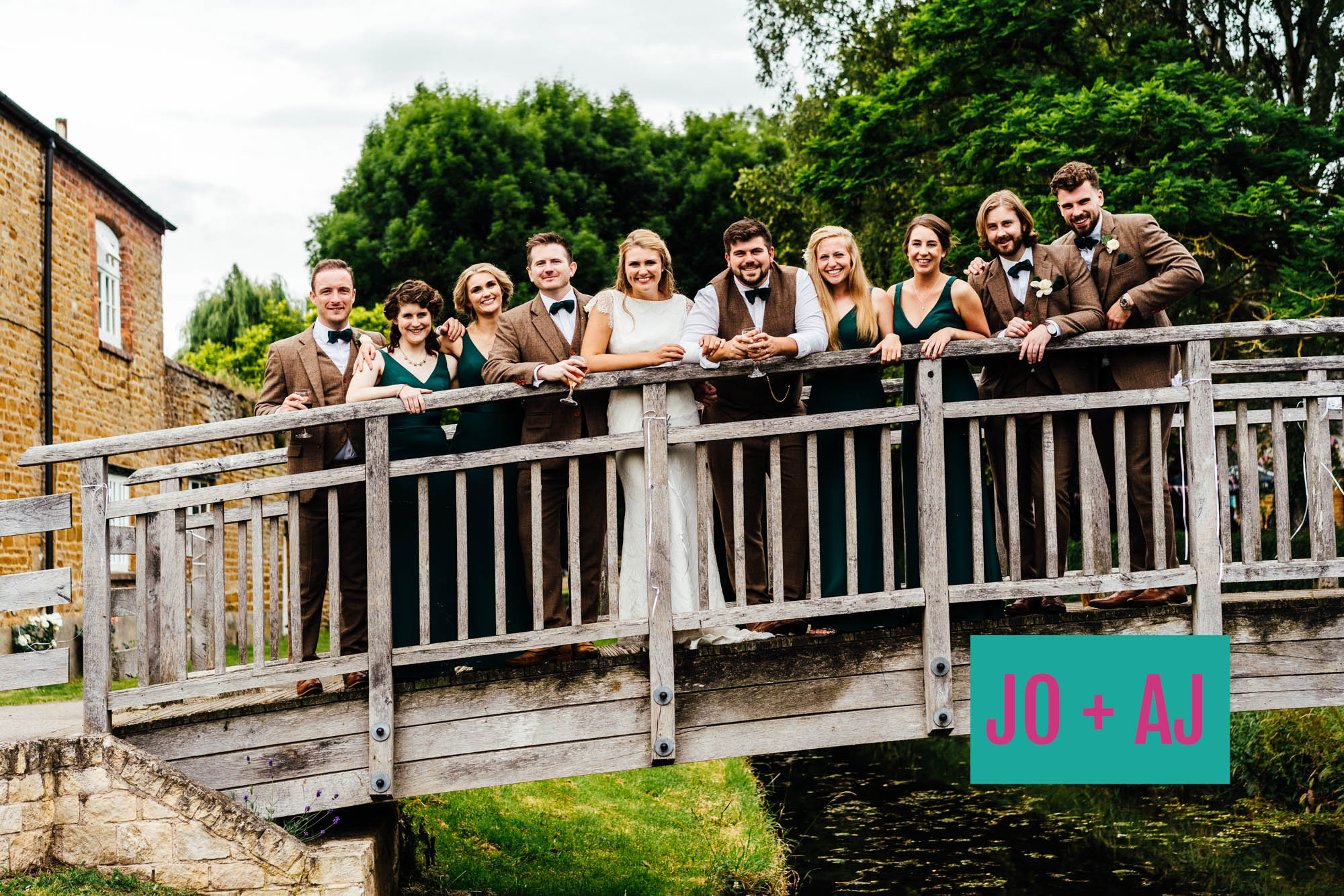 bridal party standing on a bridge in Medbourne Leicestershire